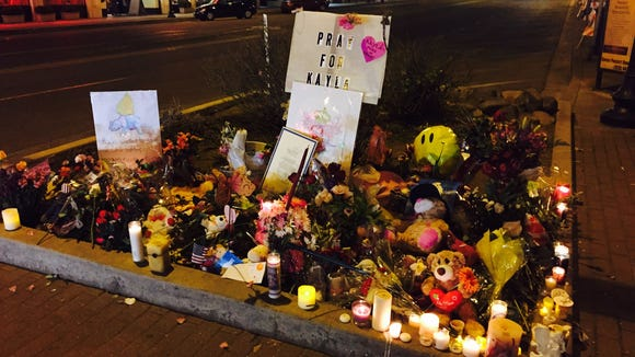 The memorial for Kayla Mueller by end of candlelight vigil in courthouse square in Prescott.