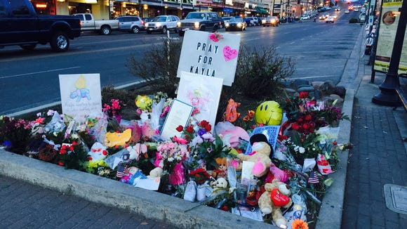 A memorial for Kayla Mueller on the corner of Gurley