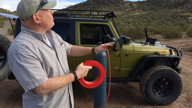 Randy Anglin of Lionstrike Forensics flies a kite that has become a tool for site surveys and evidence gathering.