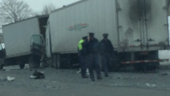 Police investigate the scene of an accident on I-75 in Detroit today.