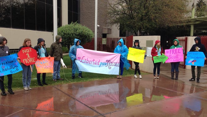 Supporters of a transgender woman held in Immigration and Customs Enforcement custody rallied outside of ICE headquarters in Phoenix on March 2, 2015 and called for her release.