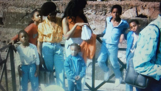 Tamika Catchings, far left in white blouse, and Kobe Bryant in blue shirt leaning against rail, are shown in the Colosseum in Rome in 1986.