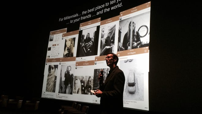 FILE: Scott Relf, CEO of PikMobile, makes a presentation at a VenturePitch SWFL event at the Silver Spot theater in Naples.