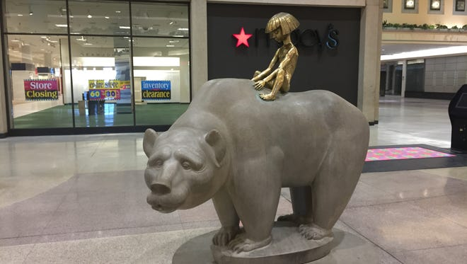 "The ""Boy and Bear"" sculpture by Marshall Fredericks stands outside the Macy's store in Northland Center mall. Photo taken March 17, 2015."