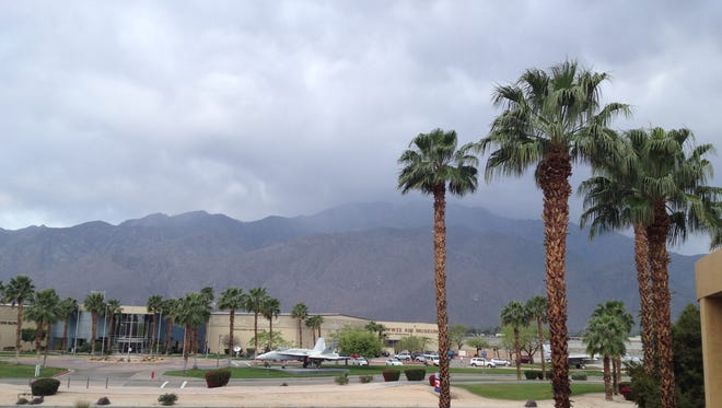 Gray clouds are dropping light amounts of rain onto Palm Springs Thursday. Showers may form later in the day, a forecaster said.