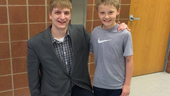 Brady Cross (left) poses with Elliot Whitney during his visit to John Harris Elementary.