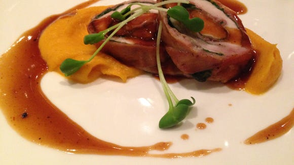 Charley G's rabbit roulade, butternut squash puree with  whiskey demi glace.