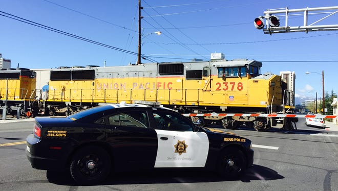 Reno police and firefighters were on the scene Wednesday morning of a train-versus-pedestrian accident near downtown Reno.