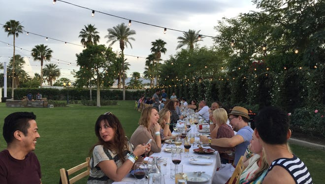 The setup for Friday night's Outstanding in the Field dinner in the Rose Garden VIP area at Coachella.
