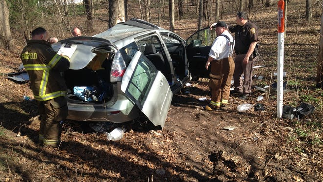 Pennfield Township firefighters examine the crash that sent a man to the hospital Wednesday afternoon.