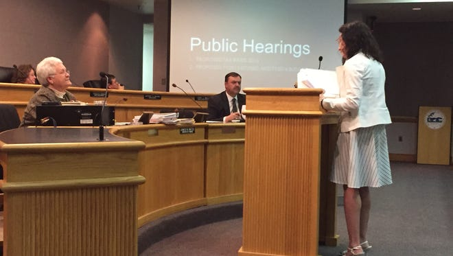 Finance Director Jennifer Whetzel, right, presents highlights of the proposed fiscal year 2016 budget to the Board of Supervisors on Wednesday just before the public hearing inside the Government Center in Verona.