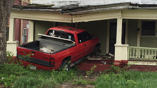 The driver of this pickup truck was taken to IU Health Ball Memorial Hospital on Monday after his vehicle was struck by a hit-and-run driver, then hit a vacant house's porch.