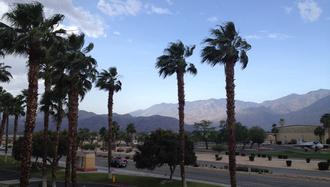 Trees sway in wind that's making its way through the Coachella Valley Tuesday. Gusts may reach 45 mph, officials said.