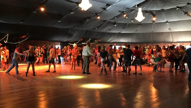 Country-western fans square-dance in the Stagecoach Honkytonk on Friday evening.