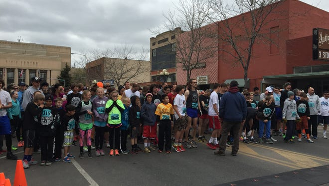 Runners get ready for the start of the 3-mile Ice Breaker in downtown Great Falls Sunday.