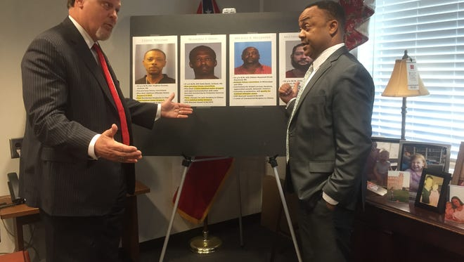 Mayor Phil Fisher and DA Robert Shuler Smith had words for each other at a Wednesay press conference.