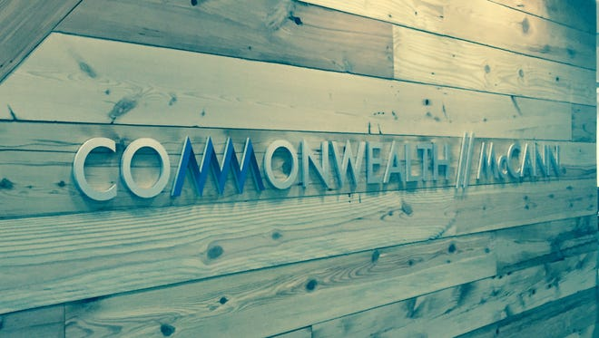 Visitors to Commonwealth//McCann's new office will see this wall, made of wood reclaimed from abandoned Detroit homes, at the ad agency's new Detroit office.