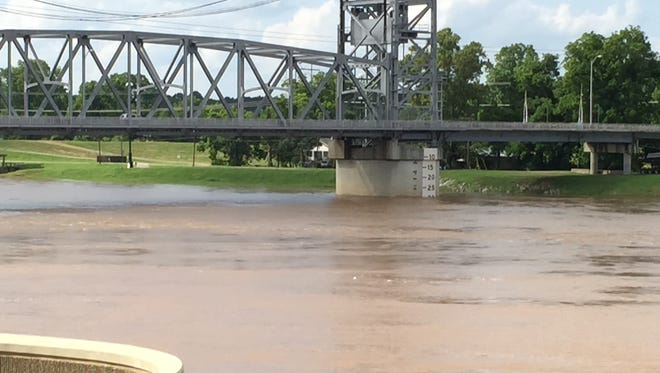 High water on the Red River flows by the Gillis Long Bridge in Alexandria. The river is nearing flood stage at Alexandria, according to the National Weather Service. That could lead to some flooding of lowland areas near the river.