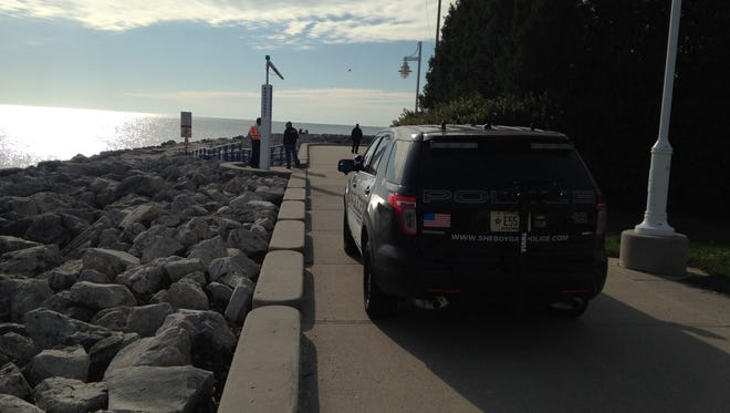 A Sheboygan Police vehicle on the scene of a search along the north breakwater of the Harbor Center Marina.