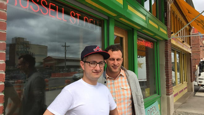 Jason Murphy (left) and Ben Hall (right) co-own the popular Russell Street Deli in Detroit's Eastern Market district. They also own a catering business, a wholesale line, and are working to open a new restaurant west of downtown.