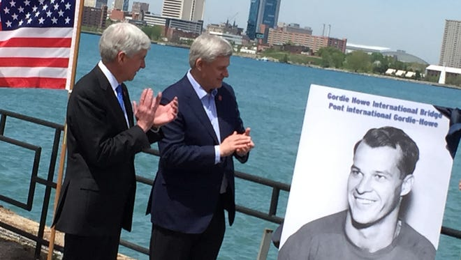 Gov. Rick Snyder (left) and Canada Prime Minister Stephen Harper (right) with portrait of hockey great Gordie Howe at the recent announcement in Windsor of the naming of the new international bridge after Howe.