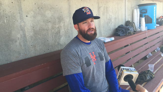 New York Mets pitcher Bobby Parnell talks to reporters in the home dugout at NYSEG Stadium on Saturday afternoon.