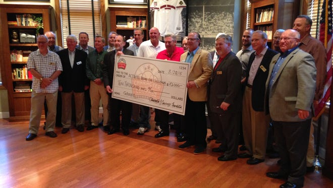 Character and Courage team members stand with Green Diamond owner/founder Bob Crotty, the Reds' Skip Schumaker, Reds broadcaster Chris Welsh, Reds Hall of Famer Ron Oester and ABC's Brian Leshner during Thursday's check presentation.