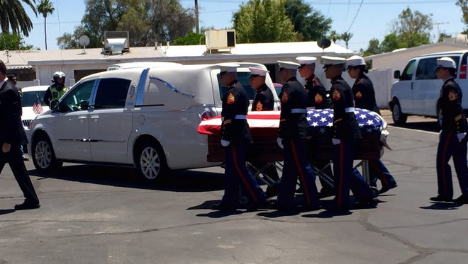 A group of Marine's helped unload Jake Hug's casket into the funeral home in Sun City.