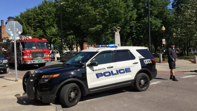 Burlington police block off College Street at the intersection with St. Paul Street on Wednesday afternoon to respond to what appeared to be a crash involving a bicyclist and a car.