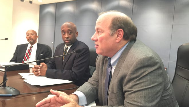 Detroit Mayor Mike Duggan talks about an actuarial study that concludes Detroit auto insurance rates could be cut by up to 37% with his D-Insurance proposal, with actuary Roosevelt Mosley Jr., center, and corporation counsel Melvin (Butch) Hollowell.
