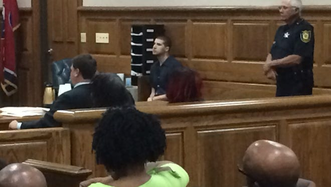 Charlie Pittman sits in court Monday morning at a status hearing.