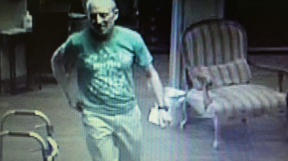 The late Mark Mayfield shown on surveillance video visiting St. Catherine's nursing home in April 2014.