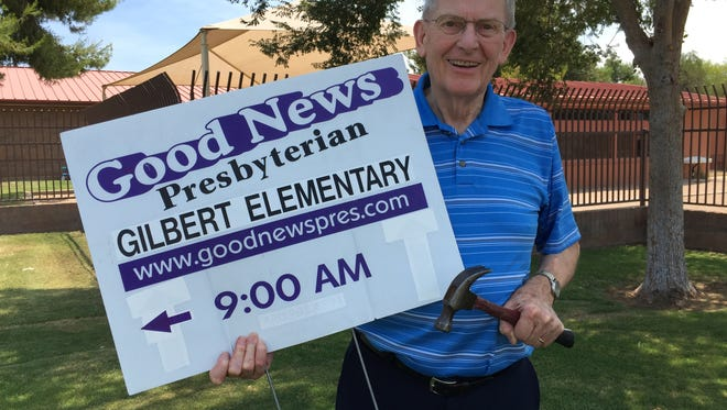 Rev. Clyde Reed, pastor of  Good News Presbyterian Church in Gilbert, puts up a sign a day after the U.S. Supreme Court ruled in his church's favor against the Town of Gilbert