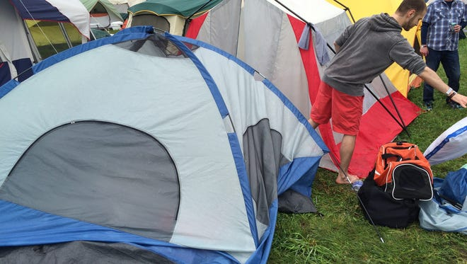 David Carlson cleans up his waterlogged tents