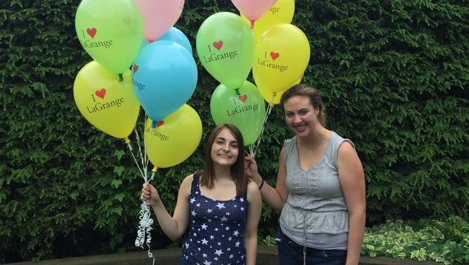 Sabina Haussmann, 16, of Pleasant Valley and Mariah Chiappolini, 15, were giving out balloons at the annual LaGrange Community Day at Freedom Park Saturday.