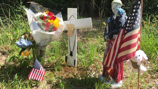 A memorial sits on the shoulder of Hickory Lane near the entrance to Stone N' Counters, where a 17-year-old Berkeley teenager died this weekend.