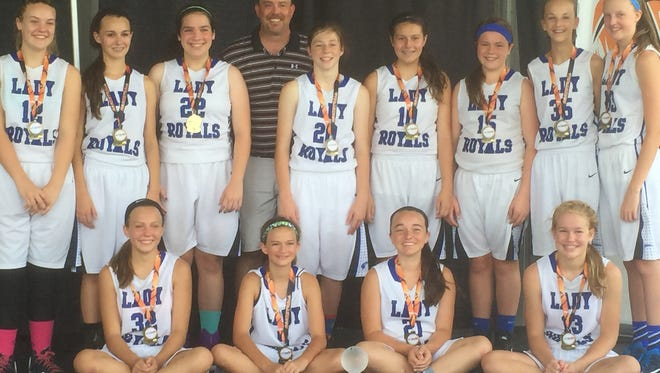 The WNC Lady Royals 7th grade basketball team.