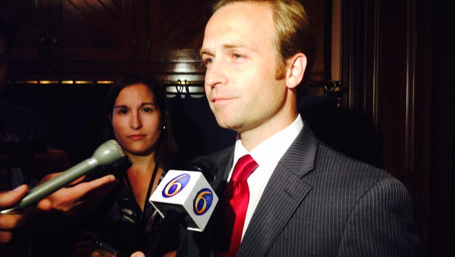 Lt. Gov. Brian Calley speaks after casting the tie-breaking vote Wednesday on a roads plan.