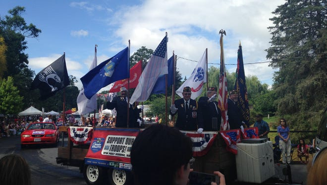 Floats drive by in Gypsy Hill Park on July 4, 2015.