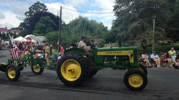 A tractor pulls a float  in Gypsy Hill Park on July
