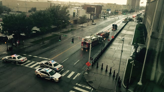 Police cars block Broadway and Seventh Street after a gas line broke Monday afternoon.