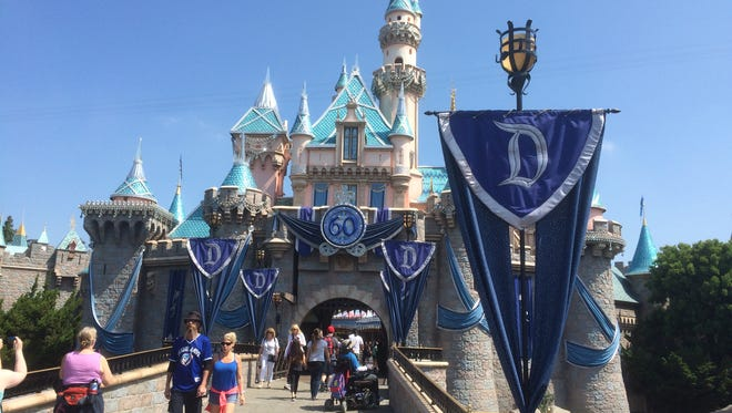 Sleeping Beauty's Castle is all dressed up for Disneyland's 60th anniversary. The secret to the glittering roof? Mylar pasted to each shingle, then layered with faux diamonds and gems.
