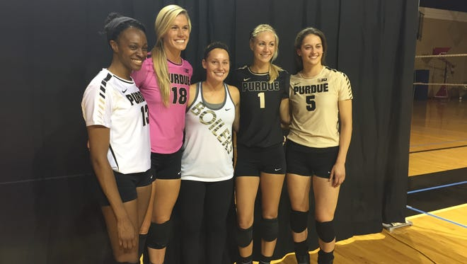From left, Purdue volleyball players Faye Adelaja, Annie Drews, Amanda Neill, Lydia Dimke and Ashley Evans at the unveiling ceremony of the team's new uniforms.