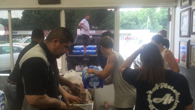 Donors through Hip Mt. Juliet pack food and supplies to help homeless individuals and families impacted by the abandoned Harding Inn fire.