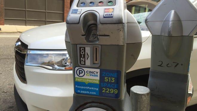 Meters in downtown Cincinnati now wear a new sticker advertising the new app.