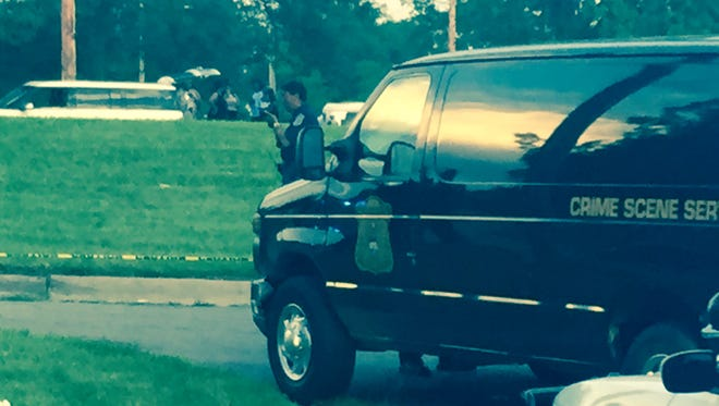 Detroit police investigate  a shooting at Maheras-Gentry Park in Detroit on July 26.