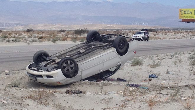 A Mitsubishi Lancer overturned on Gene Autry Trail in Palm Springs Wednesday. Its driver was taken to a hospital.