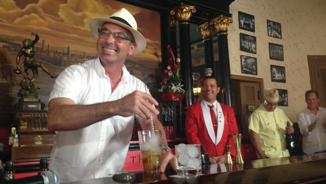 Julio Cabrera, a former Cuban cantinero who lives in Miami, mixes a cocktail at El Floridita bar in Havana. Cabrera organizes a trip to the island each year to show U.S. bartenders Cuban bar culture.