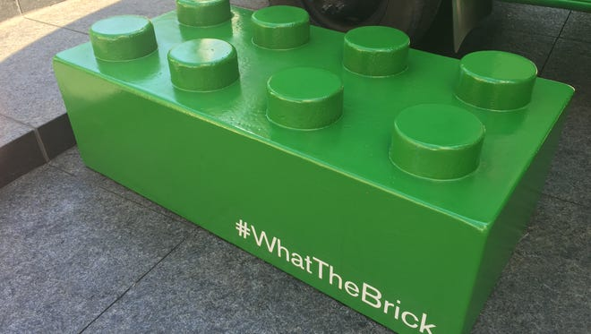 A green Lego was placed in Fountain Square.