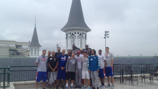 Puerto Rico's national basketball team posed in front of the famed Twin Spires at Churchill Downs. They're coached by the University of Louisville's Rick Pitino.